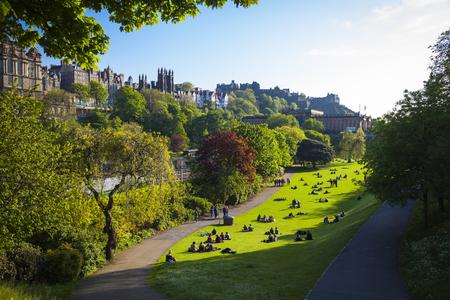 Historic buildings and a green park in Edinburgh, Scotland