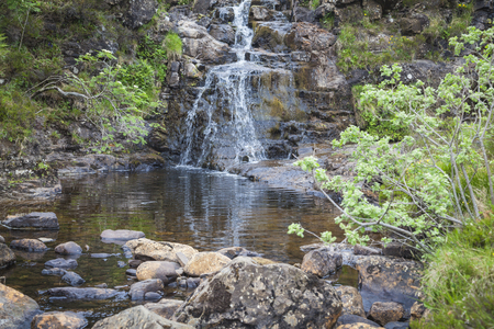 Small waterfall at the Fairy Pools on Isle of Skye, Scotland Stock Photo
