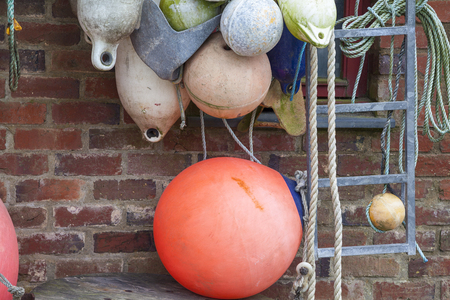 Fishing gear and buoys in a harbor in Wales