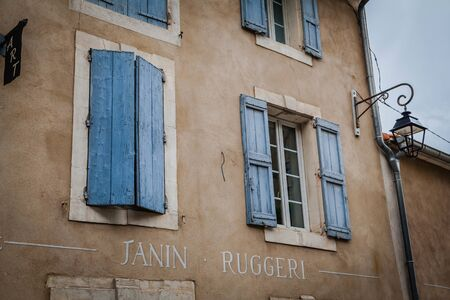 Window with coloured shutter in a small village in Provence, France Standard-Bild - 128317703