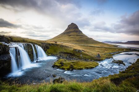 The picturesque sunset over landscapes and waterfalls. Kirkjufell mountain, Iceland Standard-Bild - 145438449