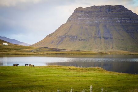 The picturesque sunset over landscapes and waterfalls. Kirkjufell mountain, Iceland
