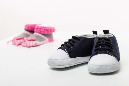 Isolated male and female baby shoes photo