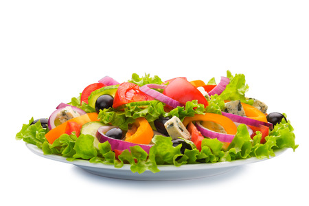 Greek salad in plate isolated on white background