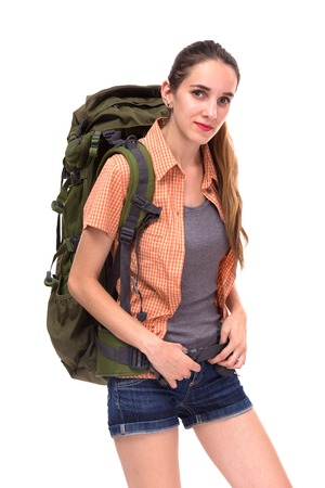 Young beautiful woman with big travel backpack, looking to camera