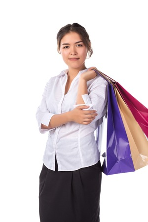Young smiling woman with color bags making shopping isolated on white Stock Photo