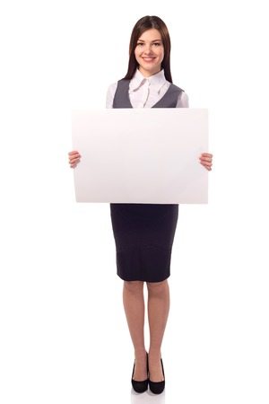 Young smiling woman with blank board placard, strict clothing isolated on white