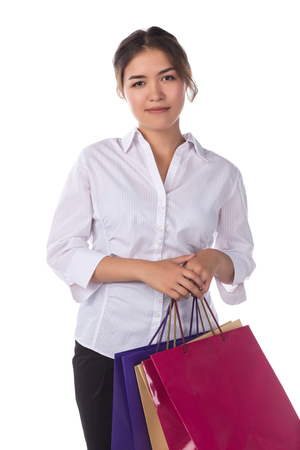 Beautiful young asian woman with bags, shopping concept, isolated on white background Stock Photo