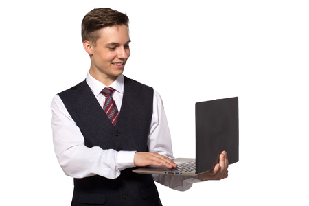 Young businessman - smiling man holding laptop and typing Stock Photo