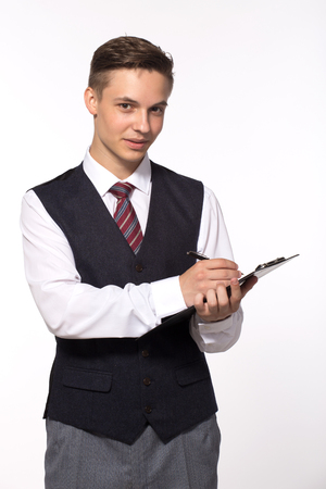 Young businessman - smiling man holding clipboard and writing