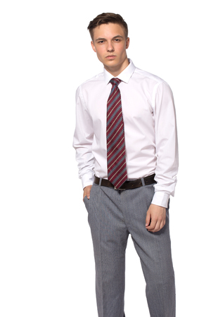 Young businessman isolated - handsome man in business style clothing looking at camera