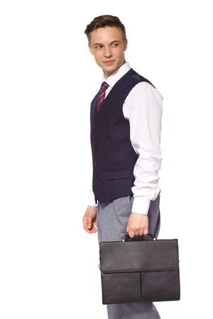 Young businessman isolated - handsome man standing with briefcase Stock Photo