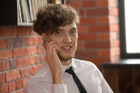 Portrait of a young businessman talking on the mobile phone