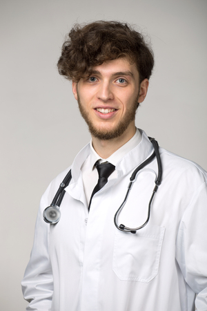 Portrait of confident young smiling medical doctor with sthetoscope Stock Photo