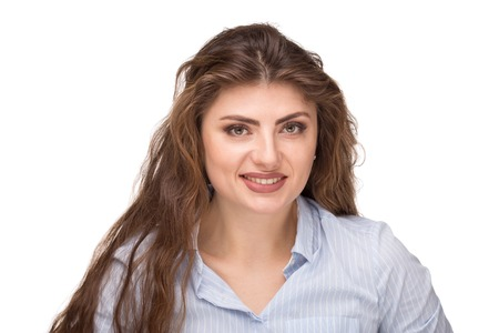 Beautiful caucasian woman with loose curly hair smiling and looking at camera.