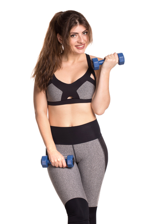 Sporty beautiful woman exercising to stay fit. Healty lifestyle concept.