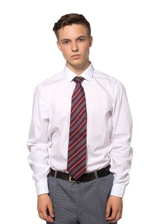 Handsome young businessman in white shirt isolated on white.