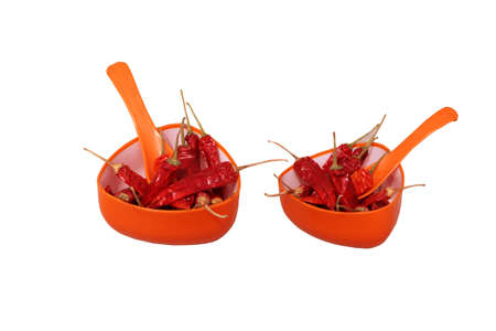 crushed red peppers: Dried Reddish Spicy Chilly in orange cup with spoon