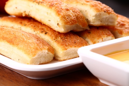 Fresh breadsticks served with dip sauce.