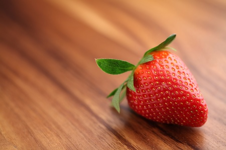 Close-up of strawberry on wood