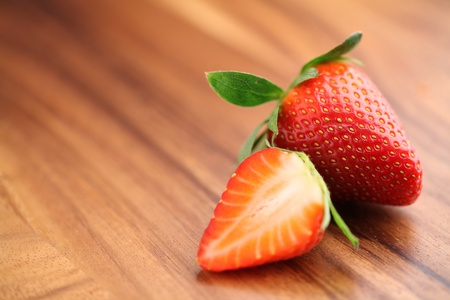 Close-up of strawberries on wood