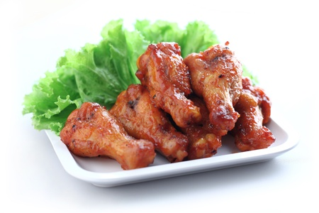 and chicken wings: Plate of chicken wings on white background Stock Photo