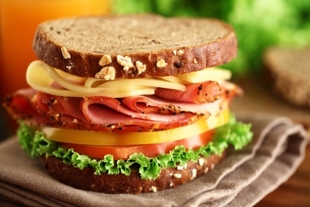 A fresh deli sandwich with tomatoes