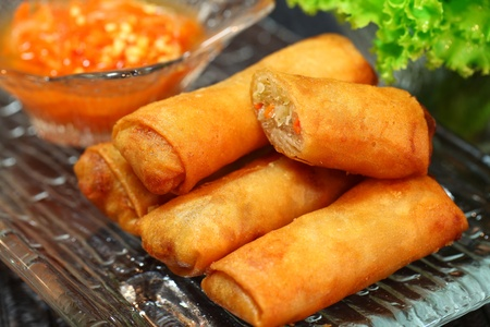 Spring rolls on clear dish