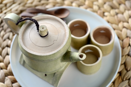 Close-up of tea in a antique cup and Teapot
