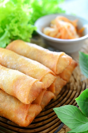 crispy spring rolls on clear dish with vegetable photo