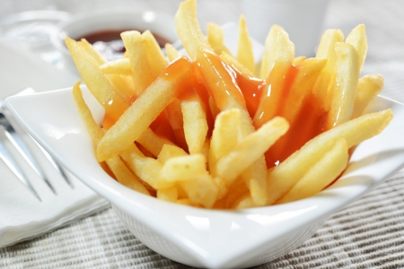 close-up of French Fries on cup and Ketchup