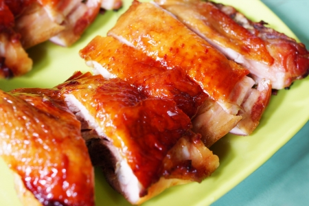 roasted chicken: piece of delicious Roasted Chicken on green dish                      Stock Photo
