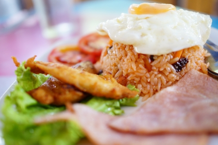 fired egg: fried rice, fired egg and fired pork on dish          Stock Photo