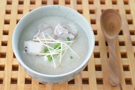 Fish Porridge (congee) served on wood table  Stock Photo