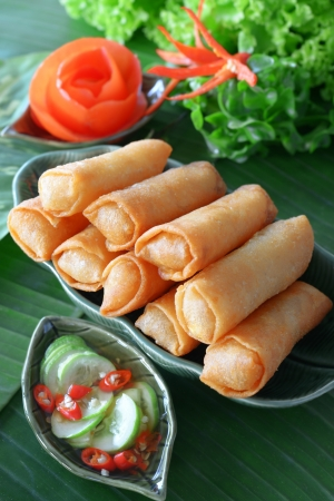 Crispy Chinese Traditional Spring rolls food on dish