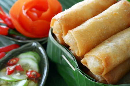 egg roll: Crispy Chinese Traditional Spring rolls food on set Stock Photo