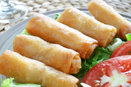 Crispy Chinese Traditional Spring rolls food on dish Stock Photo