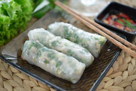 vietnamese food: fresh spring roll on glass dish with dipping