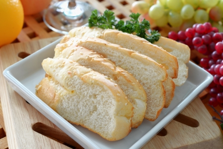 Crusty garlic and herb bread on dish