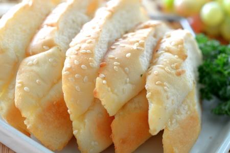 Crusty garlic and herb bread on dish