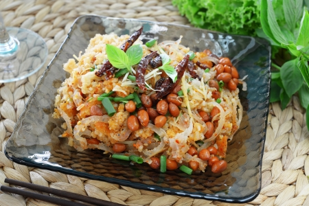 Spicy Fermented Pork and fried rice Salad on glass dish