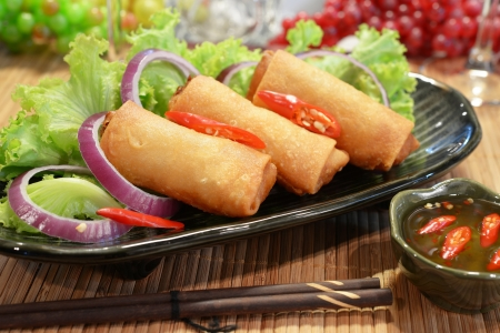 three piece of spring rolls on dish