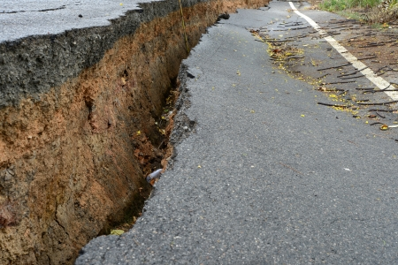 landslip: layer of broken asphalt road at rural areas. Stock Photo