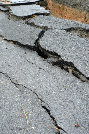 layer of broken asphalt road at rural areas. photo