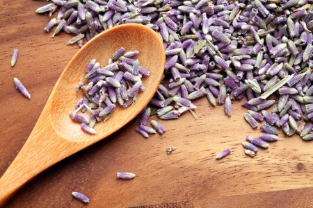 spoon of dry lavenders on wood table  Stock Photo