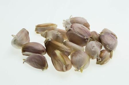 factions: Fresh garlic isolated on white background.
