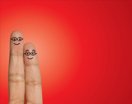 Happy Couple with Spectacles looking at each other  in Love - Concept Illustration using Fingers