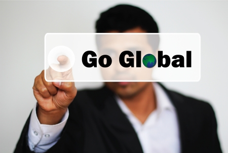 Male Professional Choosing to Go Global by clicking the Button  Stock Photo - 20378046