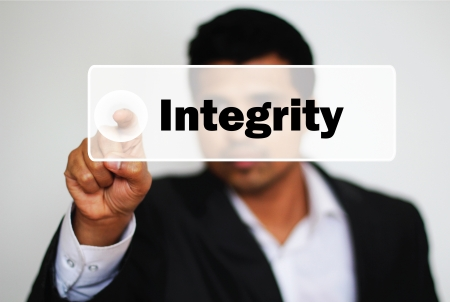ethics and morals: Male Professional Choosing Integrity by clicking the Button  Stock Photo