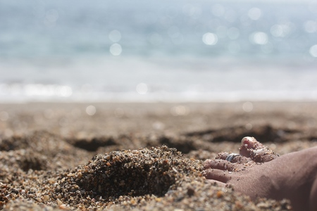 Woman relaxing near beach with barefoot on the sand with glowing sea or ocean water Banco de Imagens